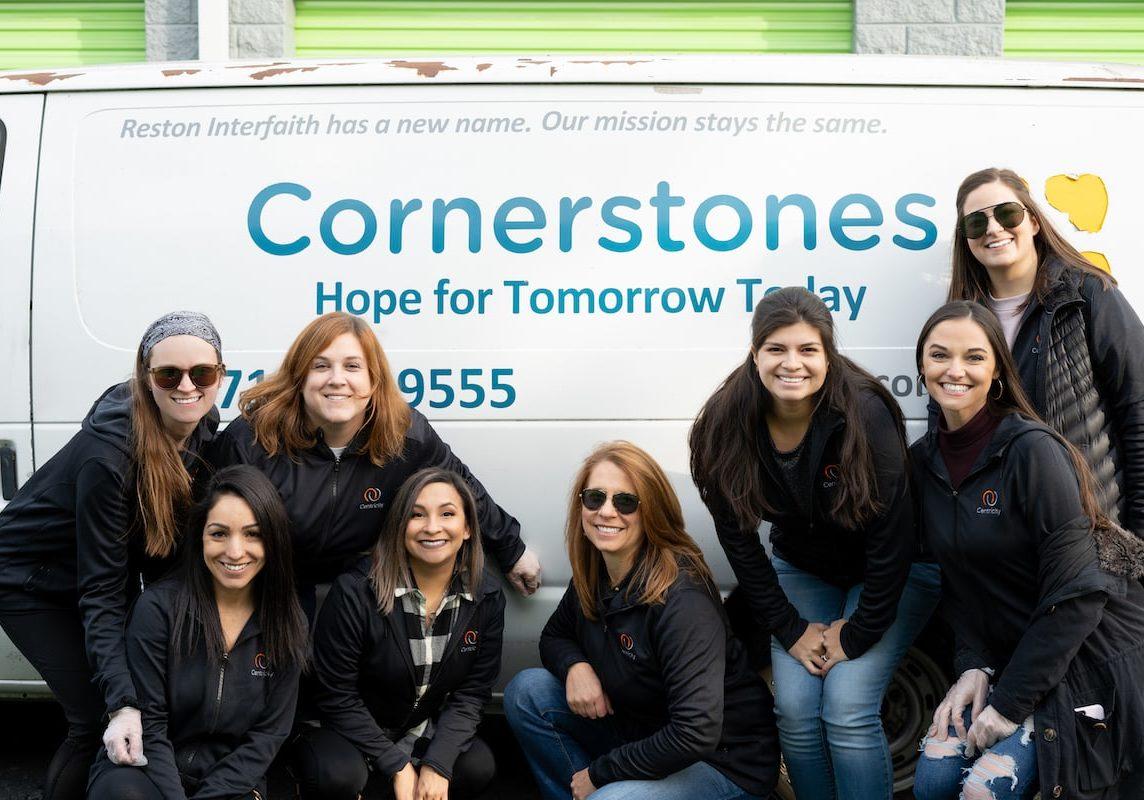 Centricity team posing with Cornerstones van